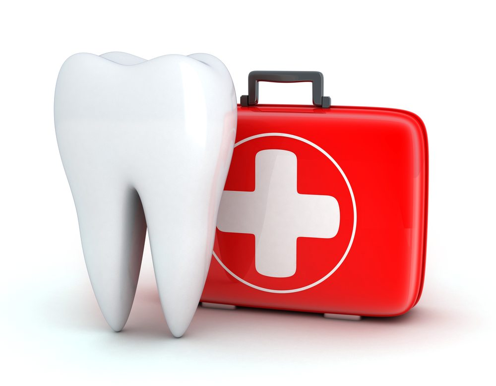 A tooth and a medical kit on a white background