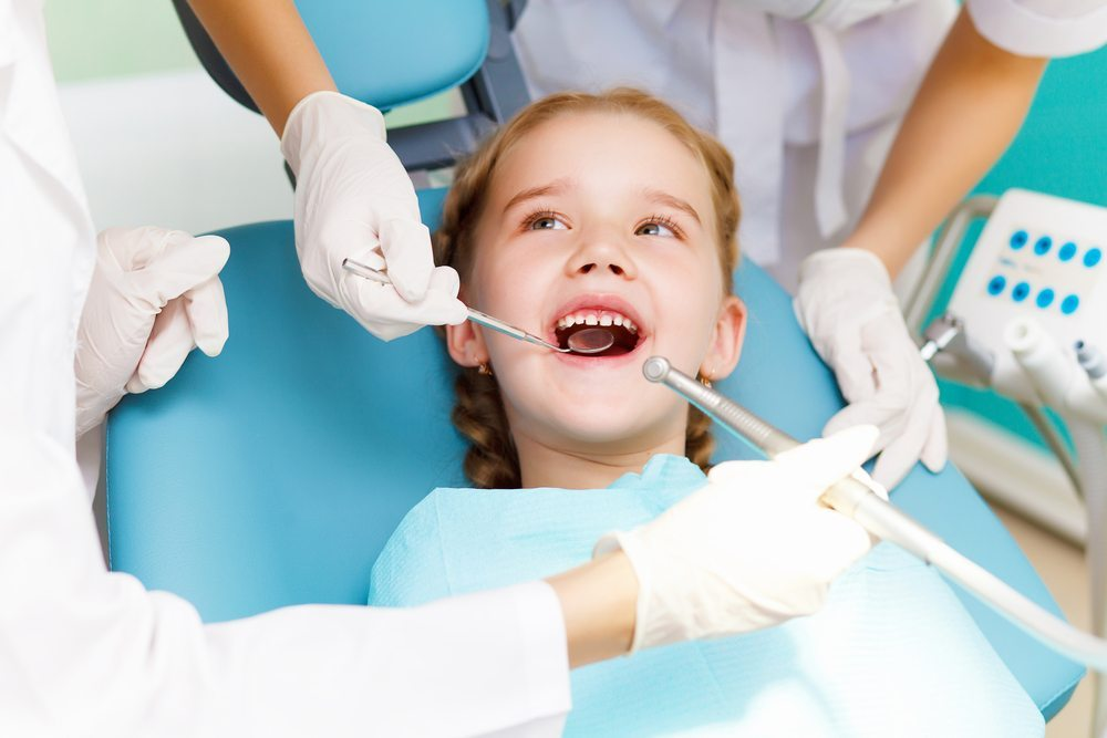 Little girl smiling at dentist check up